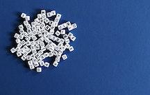 Buchstabenwuerfel als Symbolbild fuer Doktorarbeit Thema Dissertation