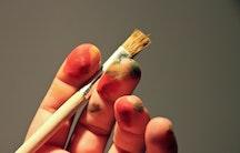 Hand Pinsel Symbolbild Selbstmarketing Wissenschaft