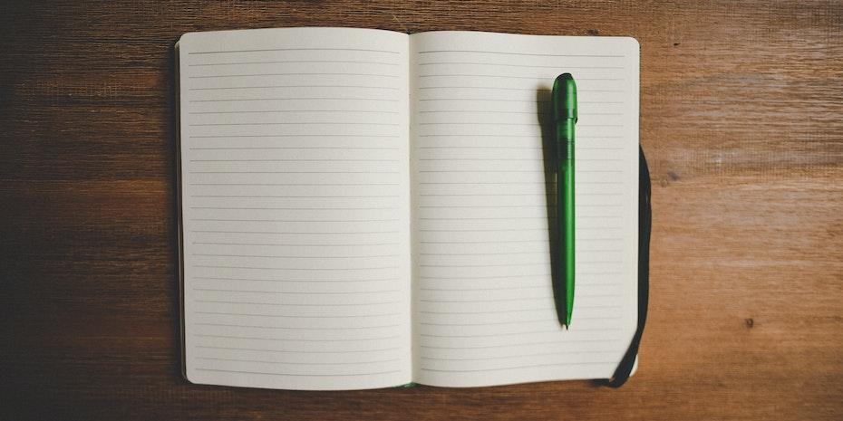 Notizbuch Symbolbild arbeitslose Akademiker