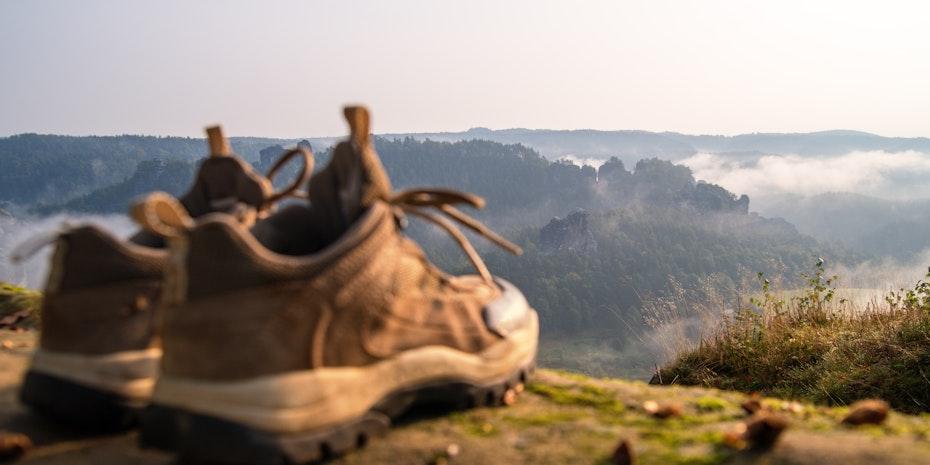 Wanderschuhe Symbolbild was bedeutet promovieren